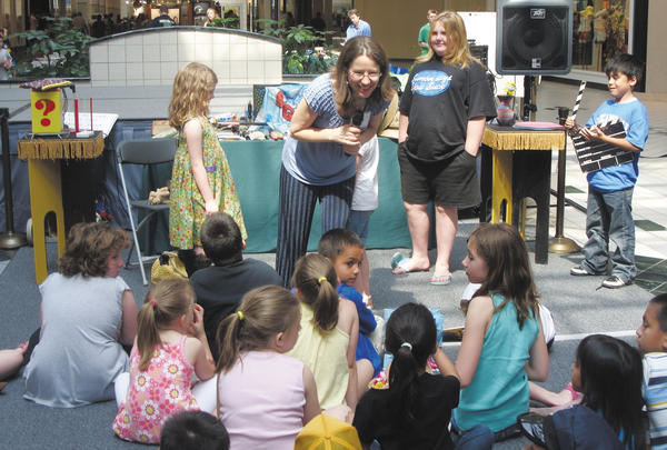 Children's author Mary Amato interacts with children Saturday at Washington County Reading Day at Valley Mall in Halfway.