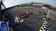 Logano slingshots past Kyle Busch for Nationwide win at Talladega