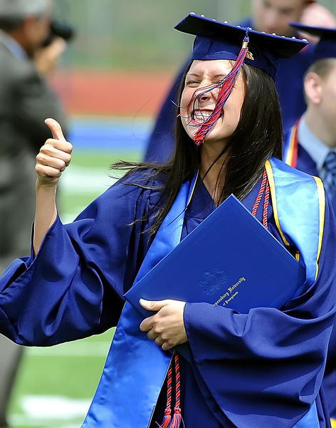 Kaitlin Rodgers of Clifton Heights, Pa. gives the thumb up after receiving her diploma at Shippensburg University on Saturday.