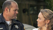Chris Bauer and Lauren Bowles as Sheriff Andy and Holli