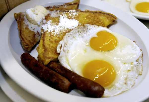 Jeremy's French Toast Combo includes two eggs and sausage, at the La Crescenta location.