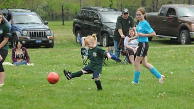 Leah Thompson boots the ball Saturday in the VIP versus U12 AYSO soccer game at Ferrellton.