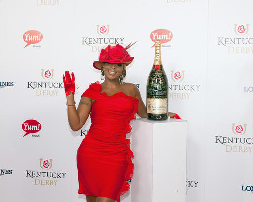 "Mary J. Blige signs a limited edition 6 Liter Moet & Chandon Imperial bottle for the brand's philanthropic initiative ""Sign for the Roses."""