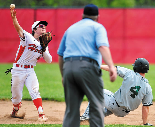 North Hagerstown's Charles Cvijanovich fires to first to try for a double play after retiring South Hagerstown's Kenny Mack on Saturday during the Hubs' 11-6 win.