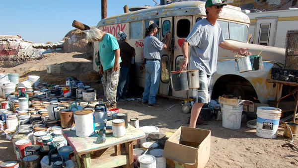 Volunteers work to clean up vandalism at Salvation Mountain.