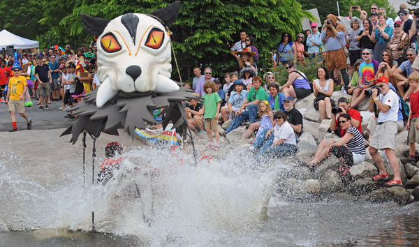 Kipplala Rides Again makes a splashy entery into the water at Canton Waterfront Park. However, it failed to stay afloat during the water worthiness portion of the 2012 Baltimore Kinetic Sculpture Race. The American Visionary Art Museum hosted the race in which amphibious, human-powered vehicles race through Federal Hill, Caton and Patterson Park in a 15-mile road, water, mud and sand race course.