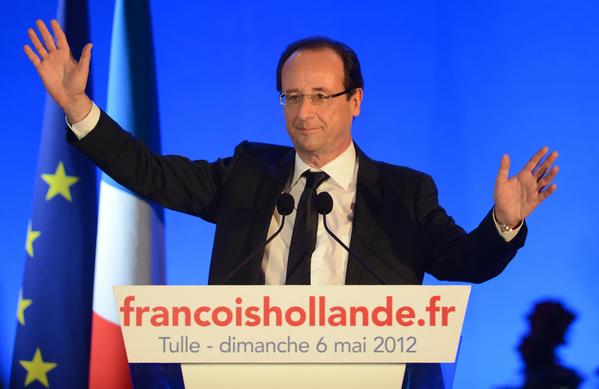 Socialist Party (PS) candidate for the 2012 French presidential election Francois Hollande waves as he arrives on stage to give a speech after the results of the second round of the presidential election on Sunday in Tulle, southwestern France. Francois Hollande was elected France's first Socialist president in nearly two decades today, dealing a humiliating defeat to incumbent Nicolas Sarkozy and shaking up European politics.