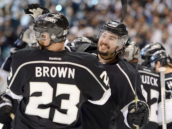Kings defenseman Drew Doughty and winger Dustin Brown celebrate after sweeping the St. Louis Blues in their conference semifinal playoff series with a 3-1 victory in Game 4 of the Western Conference semifinals at Staples Center.