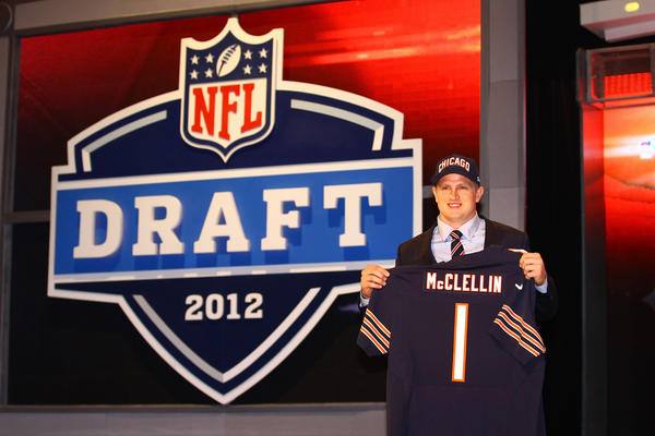 Shea McClellin holds up a jersey as he stands on stage after he was selected No. 19 by the Bears.