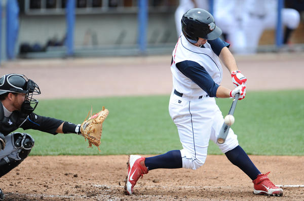Lehigh Valley IronPigs begin series against Syracuse at Coca-Cola Park on Sunday May 6, 2012.  The IronPigs won the game11-2. In photo, IronPigs,  Tuffy Gosewisch swings and hits a double during the game.
