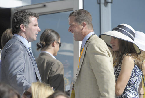 Kevin Plank, the CEO of Under Armour, chats with Ravens coach John Harbaugh at Pimlico.