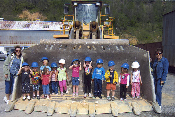Students from St. John's Preschool in Hagerstown stand in the large bucket of a front-end loader while on a field trip to U.S. Silica Co. in Berkeley Springs, W.Va.