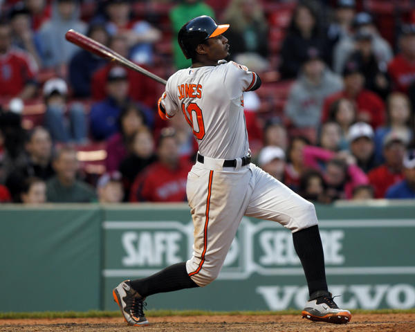 Orioles center fielder Adam Jones hits a three-run home run off Boston Red Sox pitcher Darnell McDonald during the 17th inning at Fenway Park.