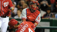 Cole Hamels gave up five hits over eight innings and Hunter Pence hit a pair of two-run home runs to lead the Philadelphia Phillies to a 9-3 win against the Washington Nationals on Sunday night.