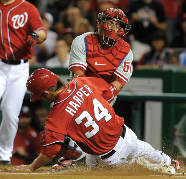 Washington's Bryce Harper steals home as Philadelphia catcher Carlos Ruiz applies a late tag during the first inning Sunday's game at Nationals Park.