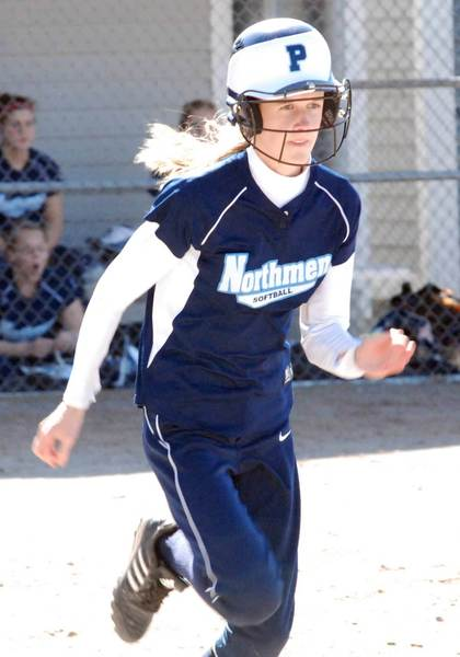 Petoskey leadoff hitter Katie Kidd races down the first base line en route to one of her five hits Friday during a non-league doubleheader sweep of Boyne City.