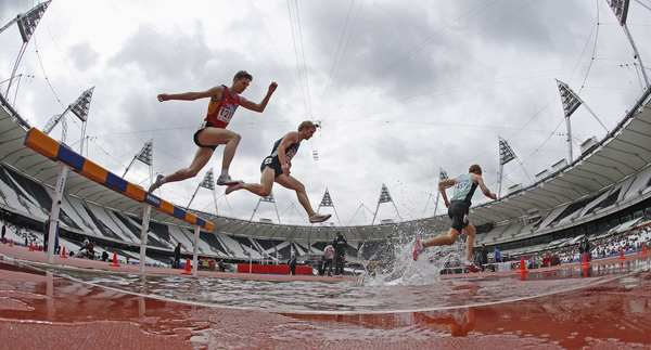 Competitors take part in the finals of the men's 3000m Steeplechase during the BUCS Outdoor Athletics Championships at the Olympic Stadium in London.