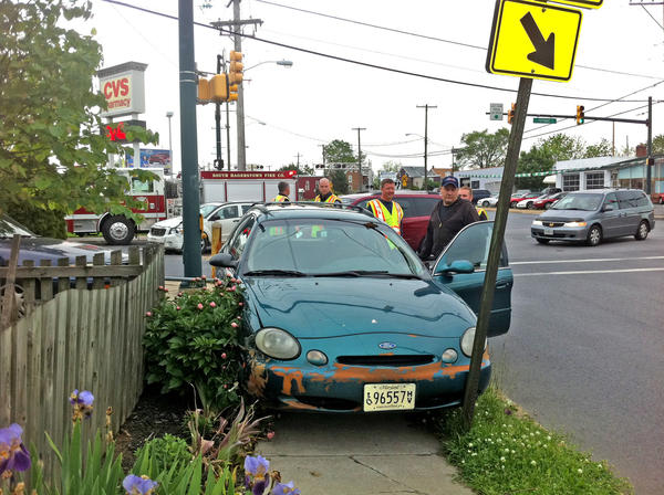 This Ford Taurus came to rest on the sidewalk on West Wilson Boulevard in Hagerstown following a two-vehicle accident at the intersection with South Potomac Street. Both drivers were taken to the hospital.