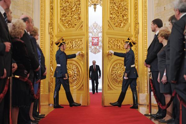 Russia's President Vladimir Putin (C) enters Andreyevsky (St.Andrew's ) Hall at the Great Kremlin Palace in Moscow¿Äôs Kremlin, on May 7, 2012, during his inauguration ceremony.