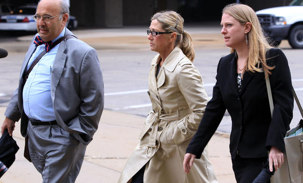 Former Dixon comptroller Rita Crundwell, center, walks into Federal Court in Rockford on Monday with her attorneys, Paul Gaziano, left, and Kristin Carpenter. Crundwell is accused of stealing over 50 million dollars from the city of Dixon.