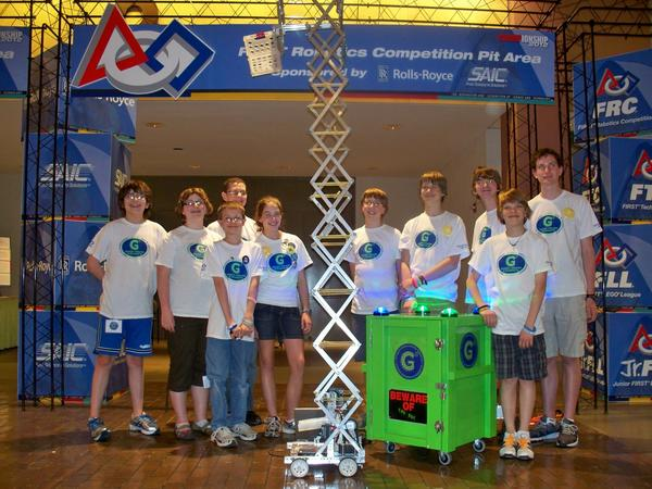 The Petoskey middle school robotics team poses with its robot at April's world robotics championship in St. Louis, Mo. From left is enrichment coordinator Heather Marvin, team members Thomas Keller, Anne Johnson, Taylor Brown, Ethan Hammond, Noah Degen, mentor Mark Marino, Max Meyerson, James McConnell, Cameron Brown, Davide Paquette, mentor Mark Brown and Drew Nicholas. Mentors not pictured are Scott Hartung and John Jerred.