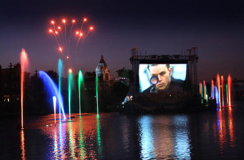 """Scenes from Universal's Cinematic Spectacular lagoon projection show featuring fountains, fireworks and 100 years of Universal movie scenes shown on a state-of-the-art """"waterfall screens,"""" at Universal Studios in Orlando, Fla., Saturday, May 5, 2012."""