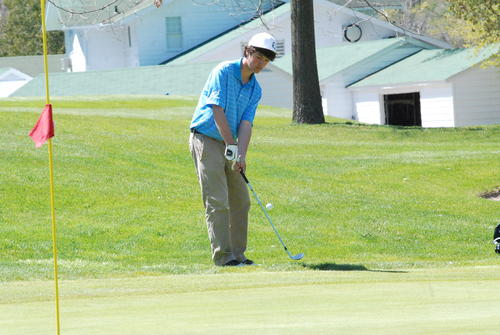 Petoskey's Tyler Spiegl chips onto the green on No. 2 Friday at Petoskey-Bay View Country Club. Spiegl shot 84