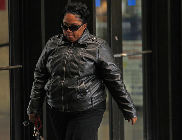 Michele Davis-Balfour, the mother of William Balfour, arrives to the Cook County Criminal Courthouse at 26th Street and California Avenue in Chicago on Monday for the trial of her son who is on trial for the murder of Jennifer Hudson's mother, brother and nephew.