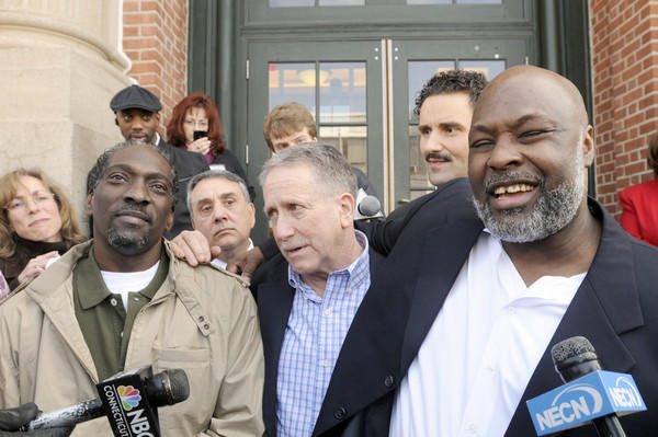 Ronald Taylor, left, and George Gould, right, rejoice in front of Superior Court in Vernon after the judge reversed their murder convictions and released them after serving 16 years in prison. Taylor and Gould were convicted of a 1993 New Haven murder. At center is investigator Gerry O'Donnell who played a key role in their release.