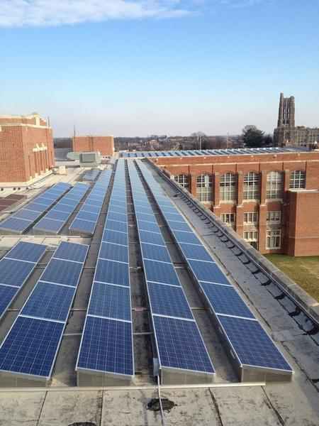 Solar panels cover roof of old Eastern High School in Waverly, now used as offices by Johns Hopkins University