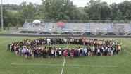 Track: County meet starts with a moment of silence for shooting victims