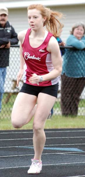 Caroline Boss of Charlevoix makes the turn during the 400-meter dash during the Harbor Springs Kiwanis 9th-10th Grade Invitational at Reynolds Field in Harbor Springs. Boss won the race in 1 minute, 3.32 seconds.