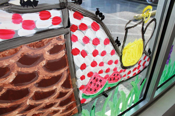 "This is a portion of an entire window with a ""Picnic"" theme painted by Waynesboro Area Senior High School art club students Alyssa Hamilton, grade 9 and Lizah Poole, grade 10 at Waynesboro Hospital."