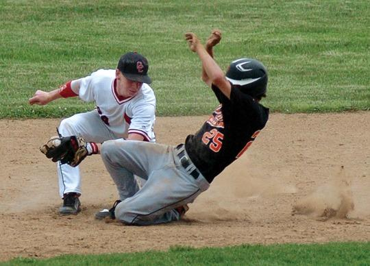 Clark second baseman Scotty Turner tags out Paris base runner Justin Moran in the second inning of the Cardinals 7-2 win over Greyhounds Monday afternoon at Cardinal Field.