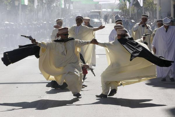 Members of a local dance troupe perform during a visit by Algeria President Abdelaziz Bouteflika at the commemoration of the Algerian war of independence during May 1945, in Setif.