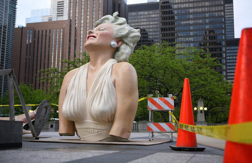 "The sculpture ""Forever Marilyn"" sits in pieces in Pioneer Court on Michigan Avenue Tuesday after being dismantled overnight.<br> <br> For more, watch of <a href=""/news/photo/chi-120508-time-lapse-marilyn-dismantled-video,0,6570025.premiumvideo"">time lapse video</a> of Marilyn being deconstructed."