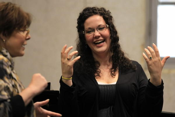 oprano Tracy Cantin (right) of the Lyric Opera's Training Wing singing for Ryan Center director Gianna Rolandi (left) during rehearsals for the upcoming repertory.