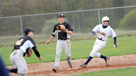 Gaylord's Chad McMillion rounds second base during the Blue Devils' doubleheader loss to Traverse City Central Monday.