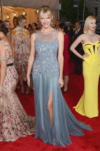 Brooklyn Decker wearing a gown by Tory Burch.