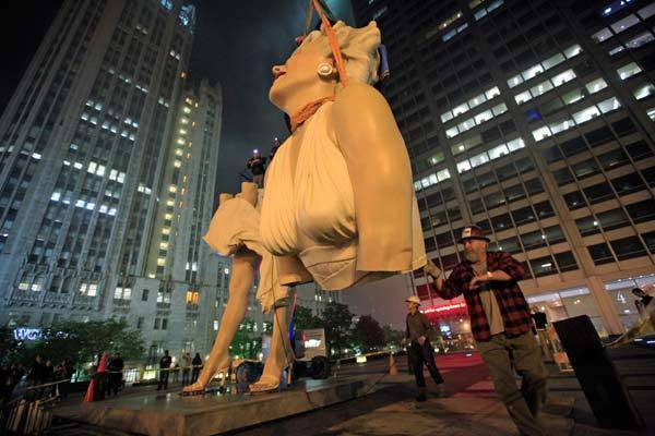 "A 26-foot tall statue of Marilyn Monroe is separated for disassembly in Chicago. The sculpture ""Forever Marilyn"" by artist Seward Johnson and based on a scene from the movie ""Seven Year Itch"", was taken down after being on display since last July."