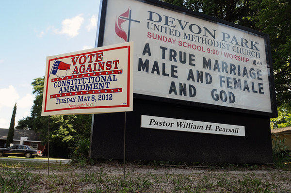 Signs display messages about gay marriage in front of the Devon Park United Methodist Church polling site in Wilmington, N.C.