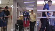 Mark Kirk has released a video showing him walking with the help of a cane and a harness as the senator talks about his rehabilitation since suffering a stroke in January.