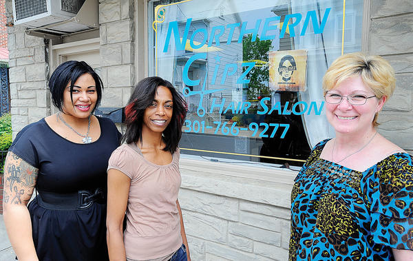 From left, stylist Morgan Turner, nail technician Kenya Austin and owner/stylist Johanna Nye stand in front of Northern Clipz Hair Salon at 138 N. Cannon Ave. in Hagerstown.