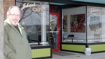John Sheets, manager of Johans Cafe in downtown Charlevoix, is shown May 1 outside the Bridge Street business.