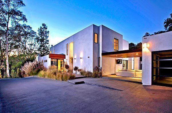 The contemporary-style house in Beverly Hills is listed at $6.995 million.