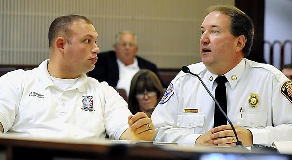 Sharpsburg Area Emergency Medical Services Assistant Chief Jonas Zeigler, left, listens to Washington County Director of Emergency Services Kevin L. Lewis as he requests funds for a new ambulance during a meeting of the Washington County Board of Commissioners. A proposed county ordinance would be designed to make it easier for emergency responders to find locations, Emergency Services Director Kevin L. Lewis said Tuesday.