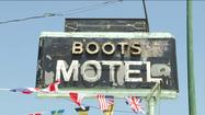 CARTHAGE, Mo. -- One of the halfway stops on the Mother Road re-opened on Tuesday with a ribbon cutting and nostalgia.  Spared from foreclosure and demolition, the Boots Motel is back in business.