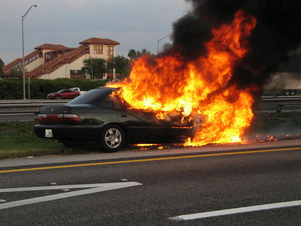 An engine fire totally destroys a Toyota on I-95 at Broward Blvd., but the driver was unharmed.