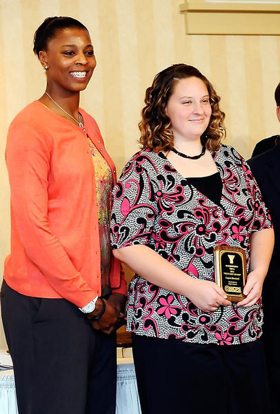 Hagerstown Community College women's basketball coach Vicky Bullett, left, poses for photos with Smithsburg High School True Grit award winner Logan Bachtell, right, during the 31st True Grit Awards Tuesday at Fountain Head County Club in Hagerstown.