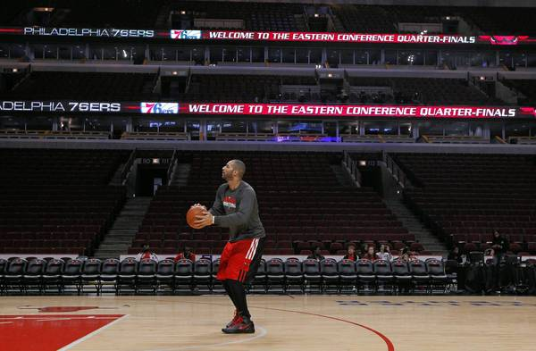 Chicago Bulls forward Carlos Boozer warms up before playing against the Philadelphia 76ers in Game 5 of an Eastern Conference first-round playoff series at the United Center.